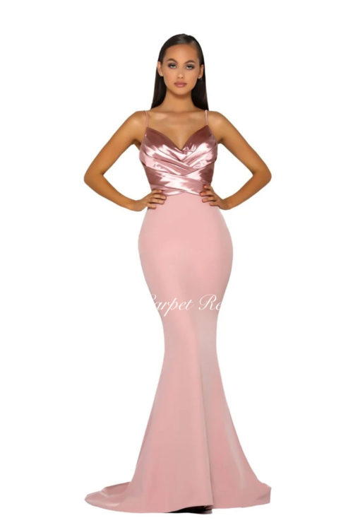Slinky blush pink dress with a satin bodice featuring a v-neck and straps.