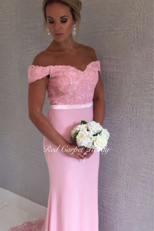 Pink off-the-shoulder bridesmaids dress with lace detailing to the bodice.