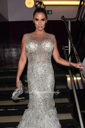 Silver an white mermaid dress with crystal embellishments to a see-through corset.