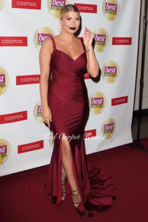 Tight fitting burgundy dress with a leg split, v-neck and straps.