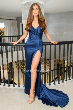Navy blue bodycon dress with a mermaid train, leg split and v-neck.