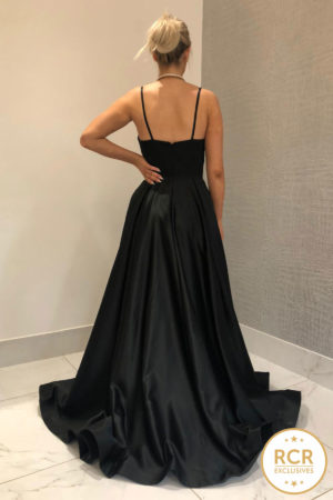 Black satin ballgown with an open back and straps.