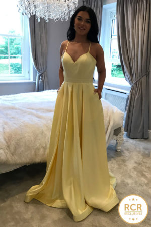 Yellow satin ballgown with a v-neck and straps.