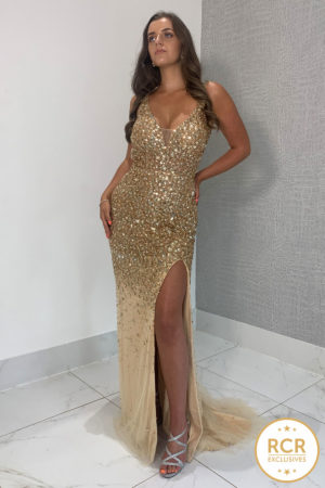 Gold hand-beaded dress with an open back and leg split.