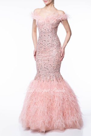 Pink mermaid dress with ostrich feathers which form the off the shoulder neckline and skirt hem.