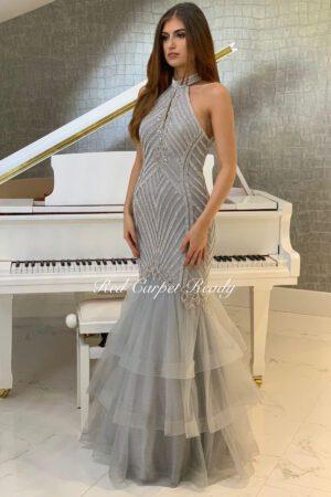 Crystal embellished silver fishtail dress with a halter neckline.