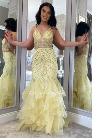Floral embroidered sparkly yellow fishtail with a corset back and straps.