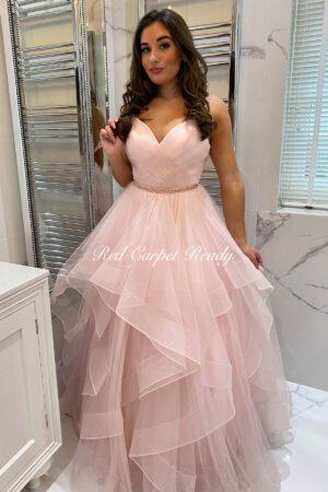 Blush pink ballgown with tiered ruffles, a v-neck and a waist belt.