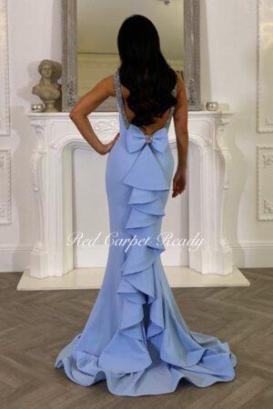 Light blue maxi length dress with cascading back detail.