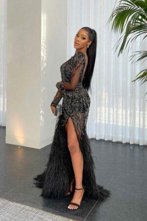 black fully embellished dress with a slit